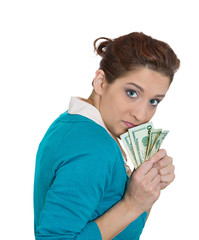 Greedy young woman holding dollar bills, money