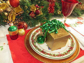 Place setting on a table decorated for the Christmas holiday