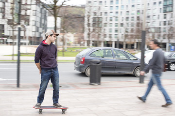 Skateboarder in action on the street.