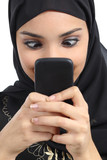 Arab woman addicted to the smartphone poster
