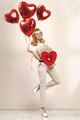 Cute blonde girl with bunch of balloons