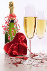 Glasses of champagne for Valentines day with heart and ribbons