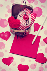 Valentines Day gift, hearts and greeting card on wooden plates