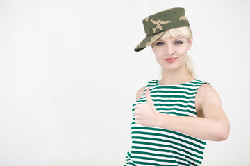 Beautiful young girl in army cap