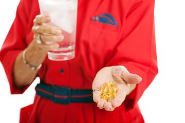 Woman Taking Omega 3 Fish Oil