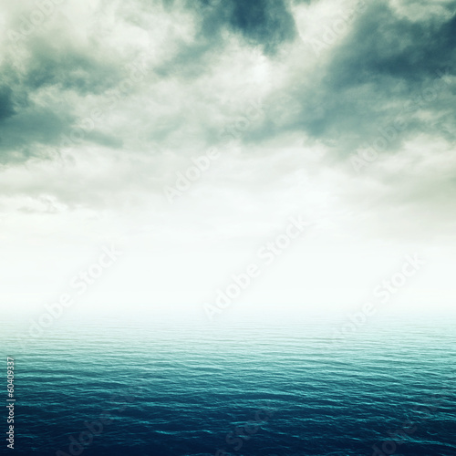 Blue sea with heavy storm clouds