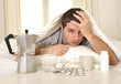 Leinwanddruck Bild - Man with headache and hangover in bed with tablets