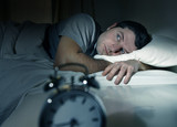 Fototapety man in bed with eyes opened suffering insomnia sleep disorder