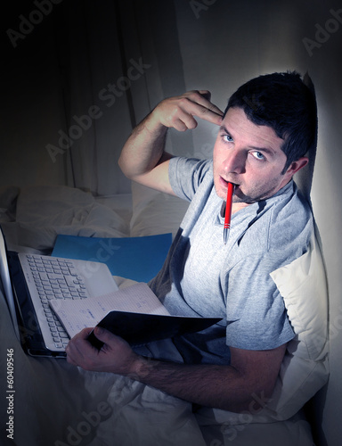 overwhelmed man working with computer late night