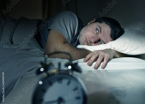 Leinwanddruck Bild man in bed with eyes opened suffering insomnia sleep disorder