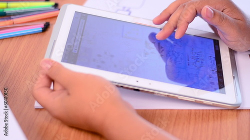 Student using and learning knowledge by tablet