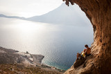 Young couple of rock climbers having a rest, Kalymnos, Greece