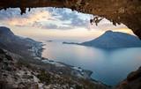 Female rock climber at sunset. Kalymnos Island, Greece.