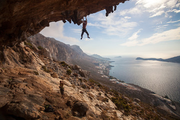 Rock climber climbing at the rock , Kalymnos Island, Greece
