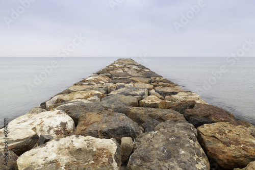 dike rocks in the sea