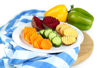 Beautiful sliced vegetables, on cutting board, isolated on