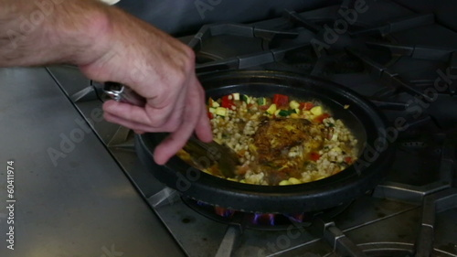 Mixing Chicken Dish on Stove