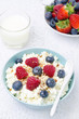 bowl of cottage cheese with berries, honey and nut for breakfast