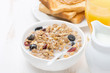 muesli with milk and dried fruit, toast with peanut butter