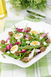 salad with quail eggs, feta and arugula, vertical