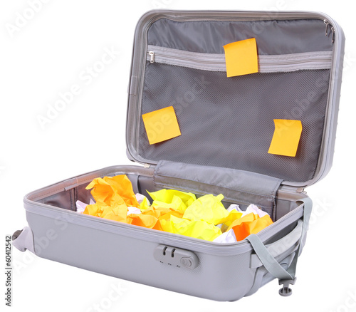 Open suitcase with paper stickers isolated on white