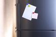 Empty paper sheets on fridge door