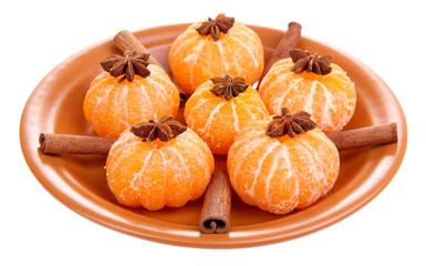 Ripe sweet tangerines and spices, isolated on white