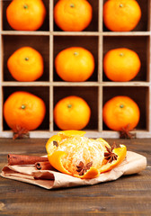 Ripe sweet tangerines in wooden box,on wooden background,