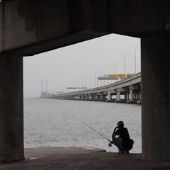 fishing under bridge