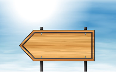 A wooden arrow signboard