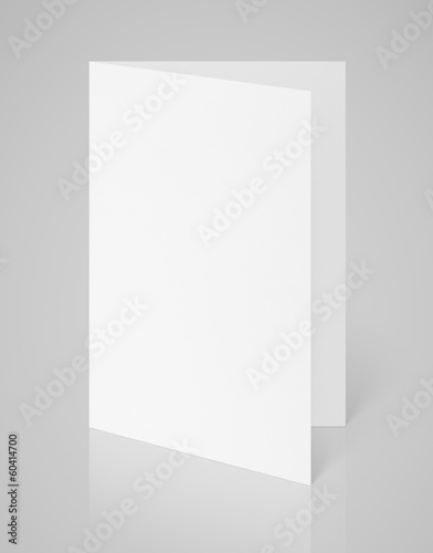 White blank folded flyer on gray with clipping path