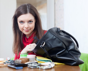 Girl looking for something in her purse