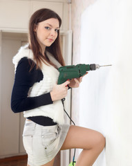 woman makes repairs at home
