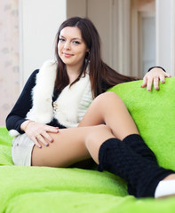 woman in leg warmers at home