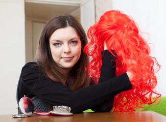 woman with red wig at home
