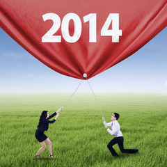 Business team pulling new year of 2014