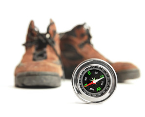 compass and hiking shoes