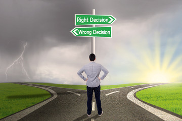 Businessman with a sign of right vs wrong decision