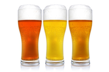 Three glasses with different beers