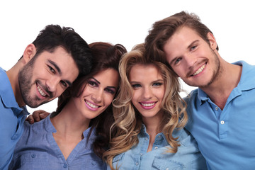 closeup picture of four casual young people smiling