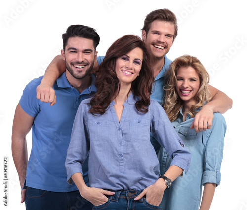 happy casual man embracing his laughing friends