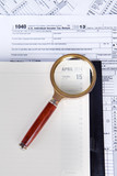Financial documents with magnifier