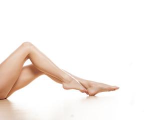pretty female legs on white background