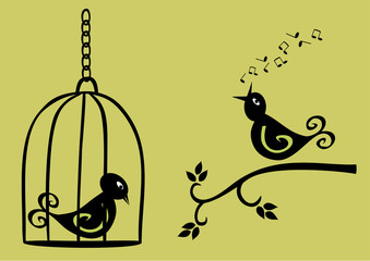 singing bird on branch and sad bird in a cage