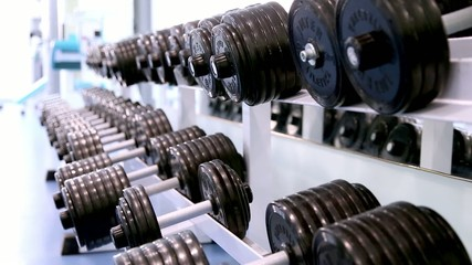 man at the gym,hand takes the dumbbell