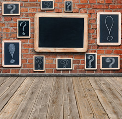Question marks and exclamation marks white chalk drawing on smal