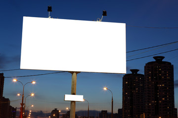 empty roadside billboards at evening in city.