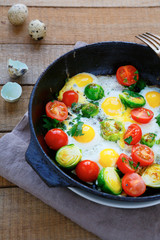 healthy and nutritious breakfast - fried eggs with vegetables