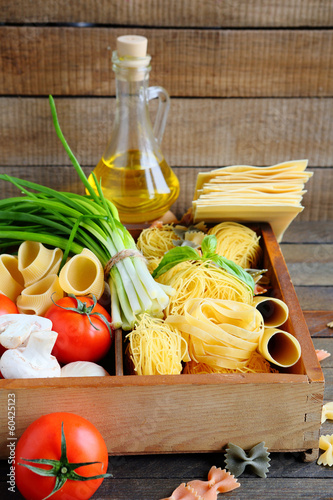 pasta and ingredients on wooden background
