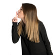 Young girl making silence gesture over isolated white background